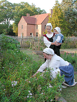 Costumed interpreters in the garden by the Old State House.